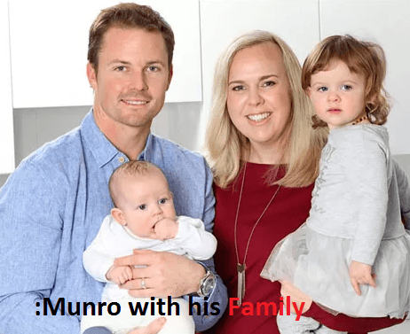 Colin Munro with his wife and children