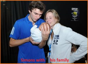 Gilles Simon with his wife and their son